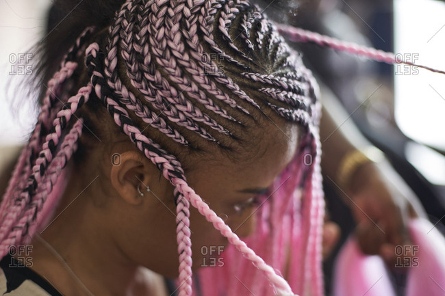 Young woman with pink braids- close-up