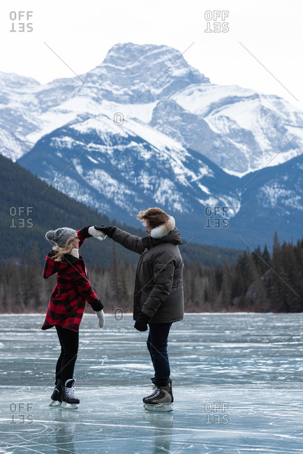 Couple dancing while standing in snowy landscape