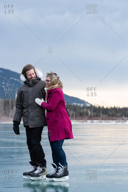 Couple interacting with each other while standing in snowy landscape