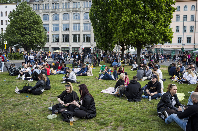 Berlin, Germany - May 1, 2019: People relaxing near Mariannenplatz on May Day