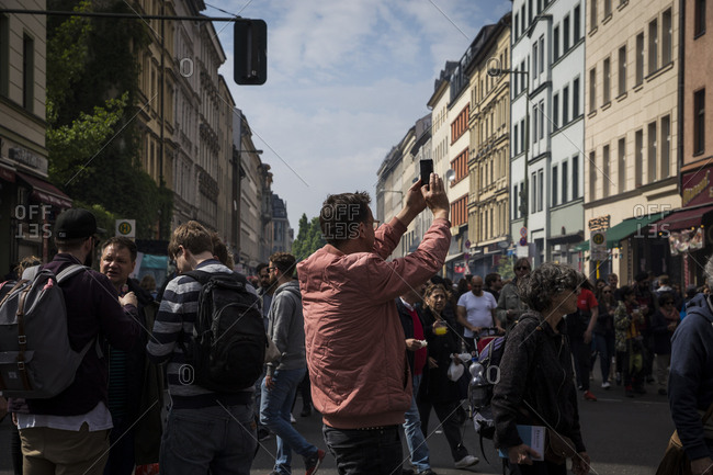 Berlin, Germany - May 1, 2019: Festivalgoers on Oranienstrasse on May Day