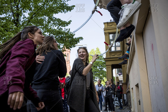 Berlin, Germany - May 1, 2019: A young woman laughing on May Day