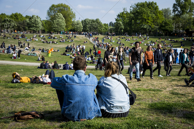 Berlin, Germany - May 1, 2019: People relax in Gorlitzer Park on May Day
