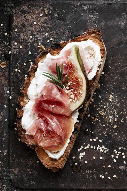 Crostino with fig, prosciutto and ricotta