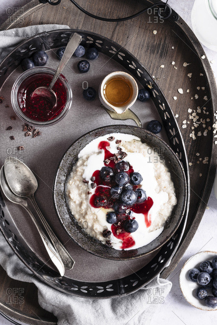 Berry oatmeal with yogurt on a tray