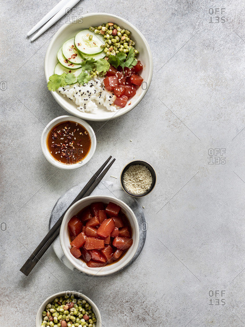 Sauteed watermelon poke bowl served with rice, cucumbers, and sprouted adzuki, lentil and beans
