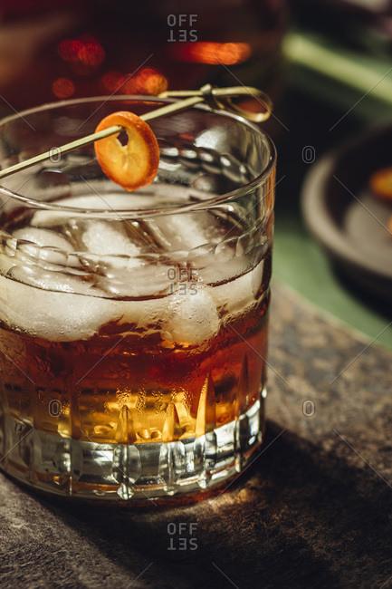 Whiskey with ice and kumquat