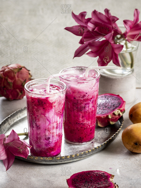 Mango Dragon Fruit Smoothie With Coconut Milk on the table