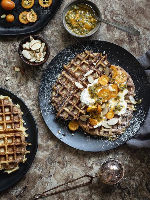 Buttermilk waffles with yogurt, passion fruit and kumquat