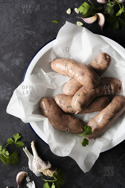 Raw Angus Beef sausages seasoned with garlic and parsley.