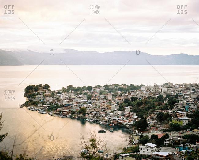San Juan La Laguna, Guatemala - January 16, 2019: Sunrise over San Juan La Laguna and Lago de Atitlan
