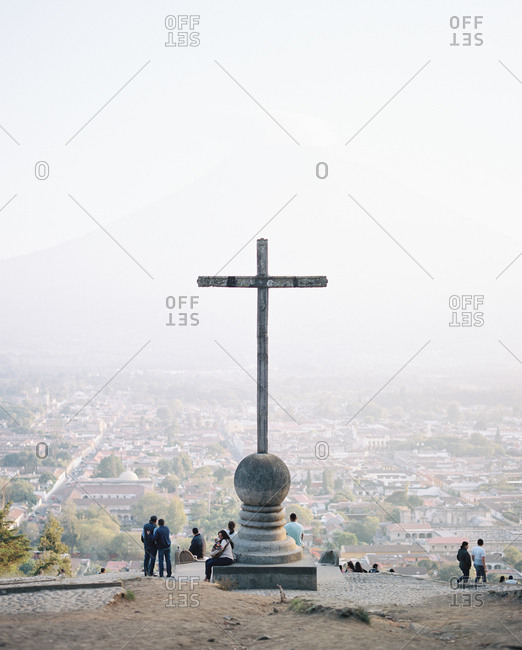 Antigua, Guatemala - January 17, 2019: Hill of the cross overlooking city on foggy morning