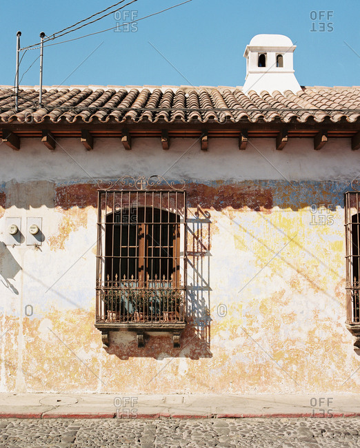 Home with bars on windows in Antigua, Guatemala