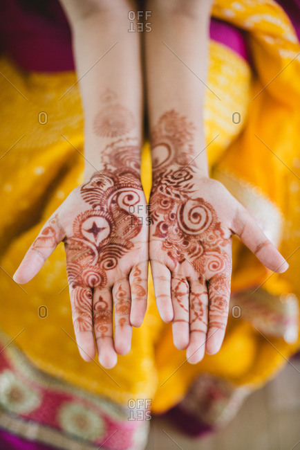 Brides hands covered in henna before wedding