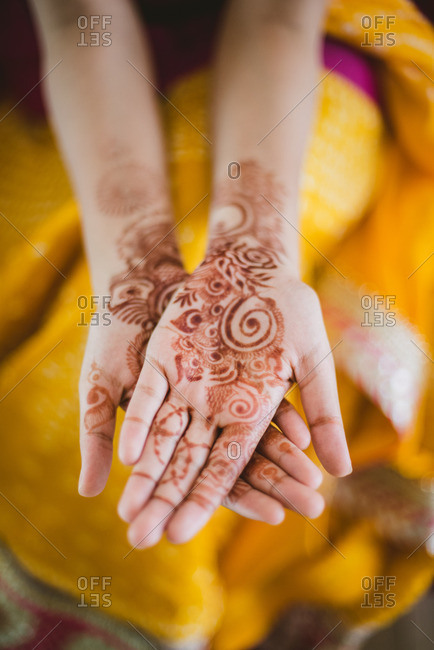 Close up of a brides hands covered in henna before wedding