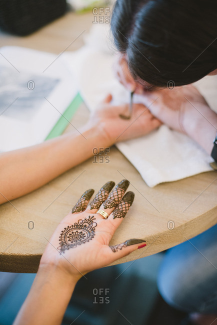 Bride getting henna tattoos before her wedding