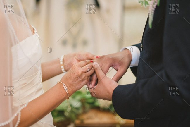 Couple exchanging rings during wedding