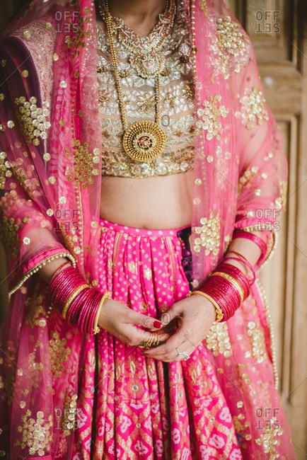 Bride wearing beautiful pink ensemble as part of a traditional Hindu wedding