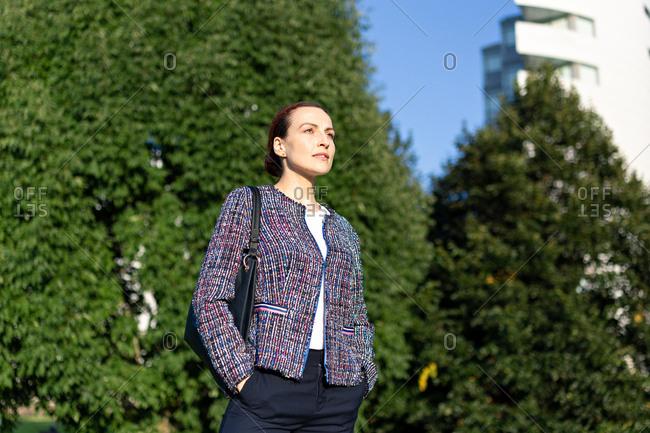 Positive female entrepreneur in elegant outfit