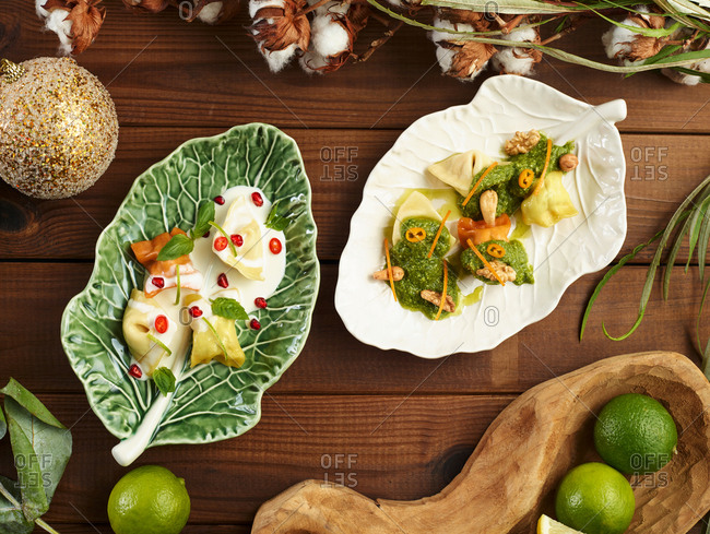 Ceramic leaf with yummy ravioli and sauce