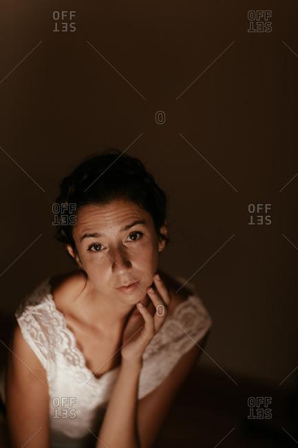 Sensual woman sitting in dark room