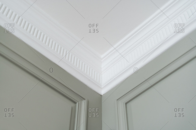 White classic molding in light room with gray matte paneled walls