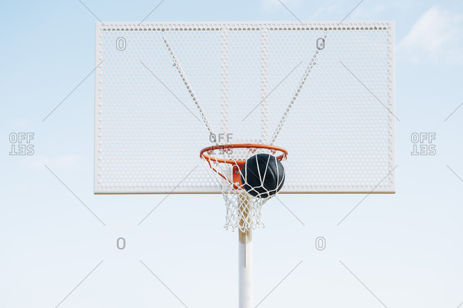 ball into basket in Outdoor basketball court and black ball