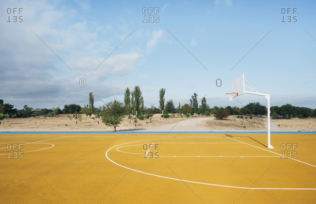 yellow basketball court outdoor.