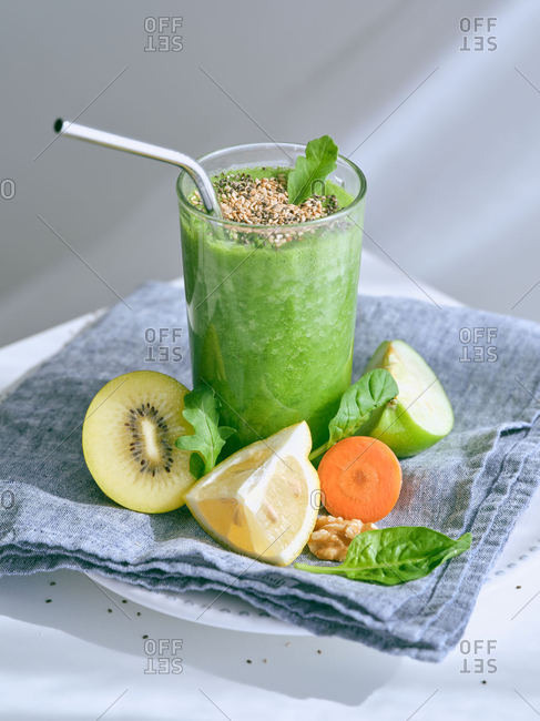 Set of ingredients for healthy smoothie and glasses with green drink