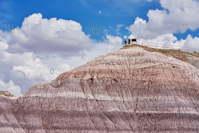 Petrified Forest National Park, Arizona - August 3, 2019: Tourists at a lookout point taking pictures on hilltop