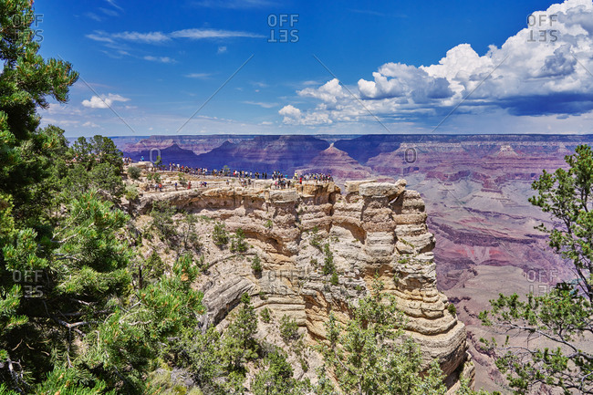 Tourists lined up on cliff at Grand Canyon National Park, Arizona