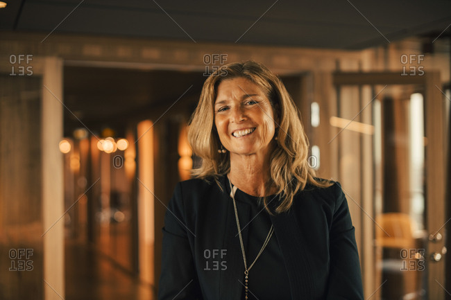 Portrait of mature female professional smiling in law office