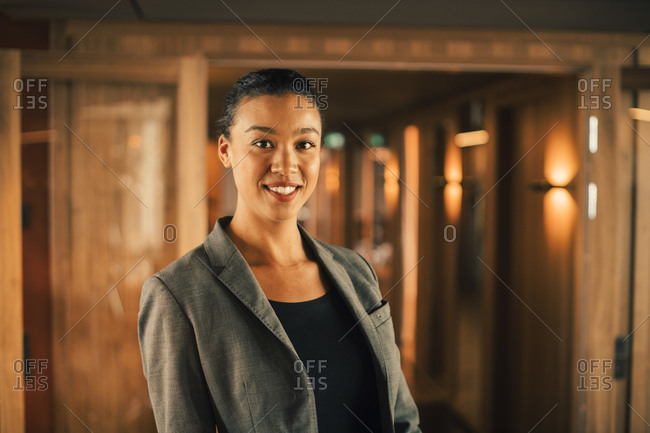 Portrait of smiling female professional at legal office