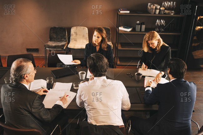 High angle view of financial advisors brainstorming in board room at office