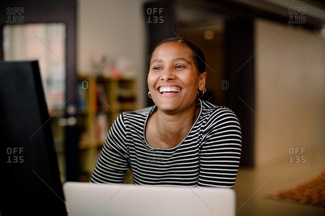 Smiling female entrepreneur looking away in office