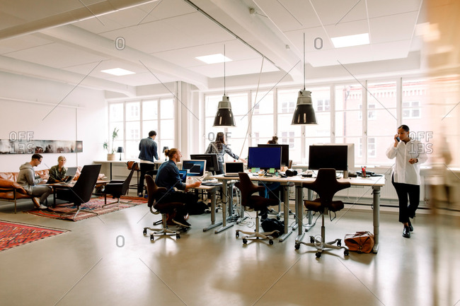 Male and female entrepreneurs working in creative office