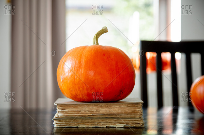 vintage books and pumpkin on a table