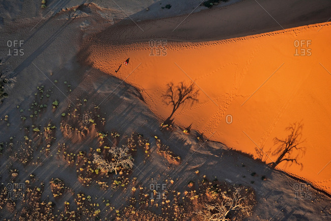 Aerial view above Namibia desert with tourist doing photo.