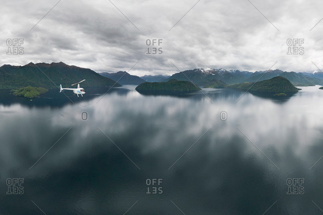 Aerial view of helicopter flying near Fiordland, New Zealand