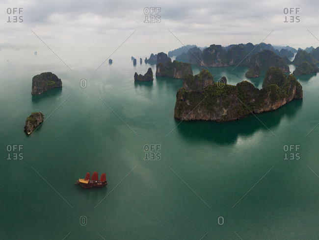 Aerial view of single boat at Halong Bay during foggy day, Vietnam
