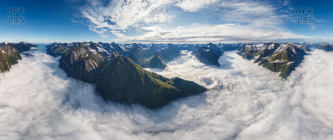 Aerial view of mountain chain above the clouds, Norway.