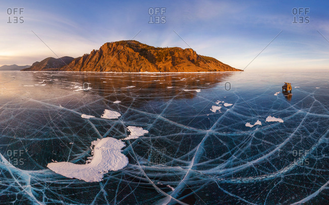 Aerial view of car crossing the frozen lake Baikal, Russia