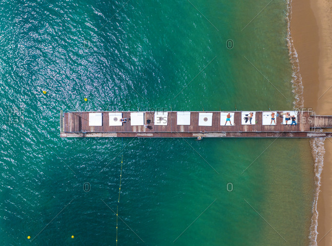 May 27, 2014: Aerial view of people resting on wooden pier in Cannes, France