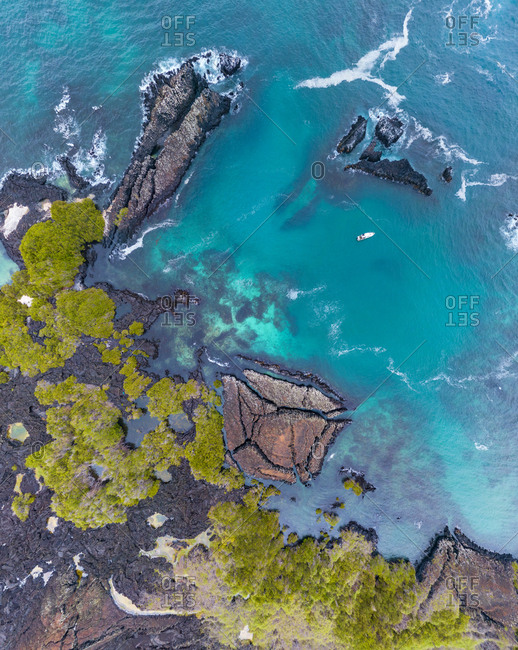 Aerial view above of island archipelagos at Galapagos.