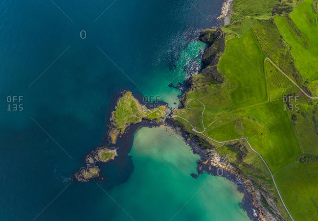 Aerial view above peninsula off the Atlantic Coast of Northern Ireland, UK