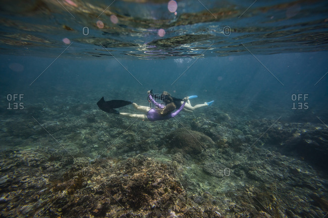 Young women snorkeling, Bali, Indonesia