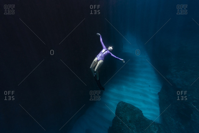 Young woman diving underwater, Bali, Indonesia
