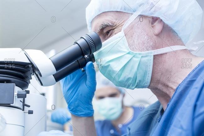 Surgical team performing laser eye surgery.