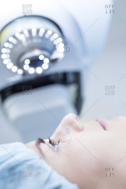 Patient undergoing laser eye surgery.