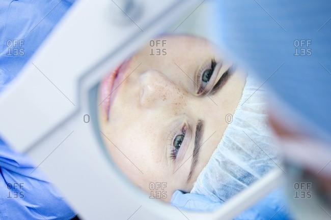 Patient undergoing eye surgery.